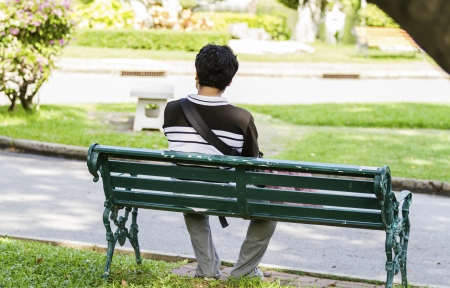 24635241 - man sitting alone on park